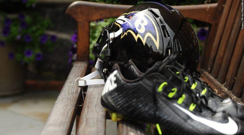 Ravens cleats and helmet