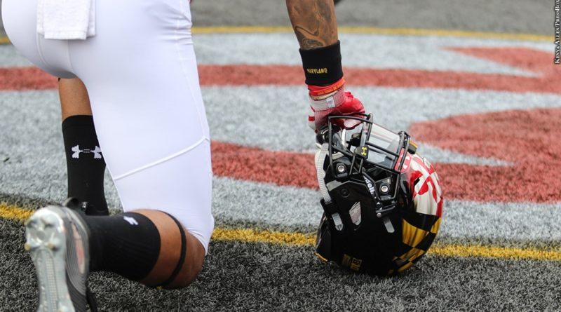 Maryland football player with helmet