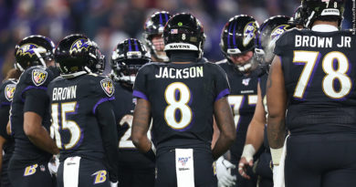 Ravens huddle with Lamar Jackson