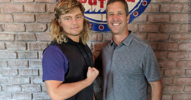 Brian Pillman Jr. and John Harbaugh