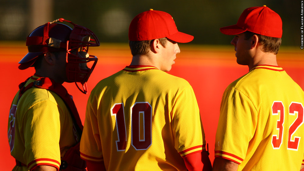 Chris Holt (No. 32) during a mound visit as Flagler's pitching coach