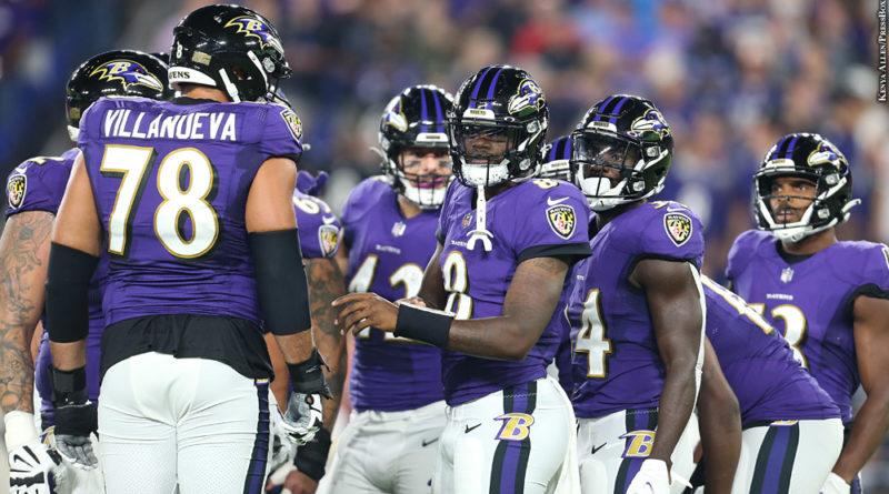 Ravens huddle with Lamar Jackson